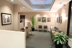 Moats Dental waiting room with framed portraits on the wall and chairs for patients