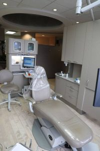 Moats Dental examination room with a computer and an adjustable seat for patients