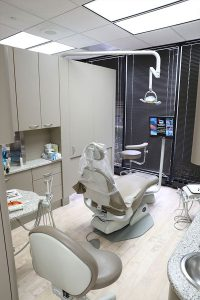 Moats Dental examination room with a tv and dental tools by the patient's chair